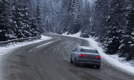 sudden: Snowy road with traffic sign  Sudden and heavy snowfall on a country road. Driving on it becomes dangerous