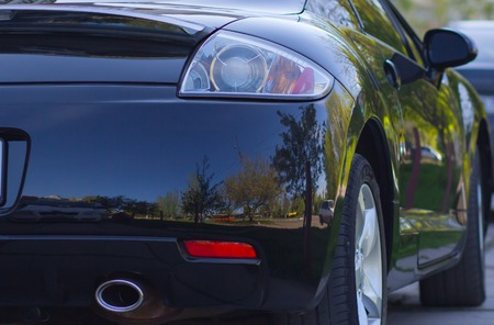 airbrushing: Rear-side view of a luxury car with natural reflection airbrushing