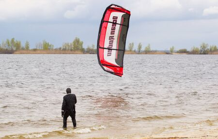 buisiness: Cherkasy, Ukraine - APRIL 21, 2016: Male office workers in suits ride kites. Business and Sports Festival. Editorial