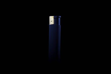 cigarette lighter: Cigarette Lighter on a black background in dark.