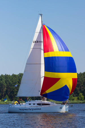 deportes nauticos: PEREYASLAV, UKRAINE- AUGUST 6, 2016: Boat in sailing regatta. Cup of Pereyaslav 2016