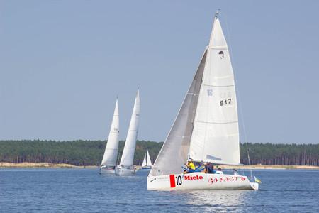 regatta: PEREYASLAV, UKRAINE- AUGUST 6, 2016: Boat in sailing regatta. Cup of Pereyaslav 2016