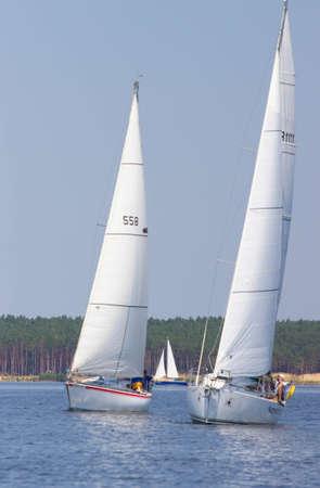 PEREYASLAV, UKRAINE- AUGUST 6, 2016: Boat in sailing regatta. Cup of Pereyaslav 2016