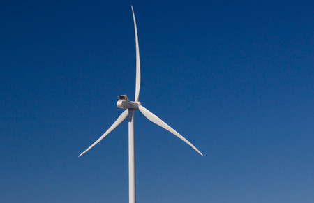 power production: Windmill for electric power production on blue sky