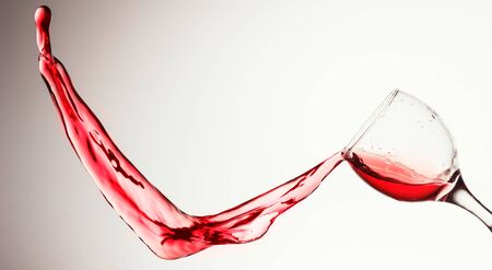Red wine splash on the white background