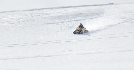 mountin: Man driving snowmobile in winter mountin Stock Photo