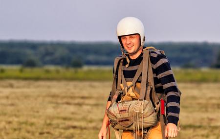 Sutiski, Ukraine - June 24, 2017: Skydivers carries a parachute after landing. Skydive Ukraine is the skydiving center located at Sutiski Aerodrome, about 20 km southwest of Vinitsa, Ukraine.