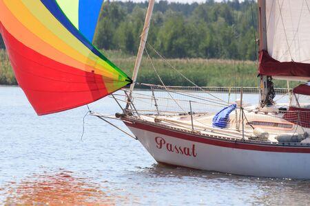 PEREYASLAV, UKRAINE- AUGUST 5, 2017: Boat in sailing regatta Cup of Pereyaslav on a bright sunny day