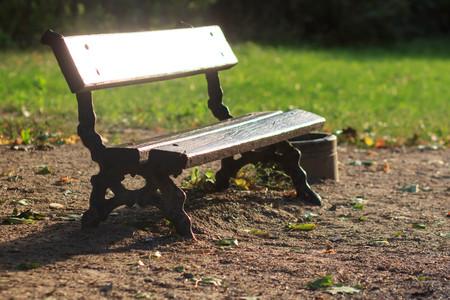 wooden park bench at a park Фото со стока