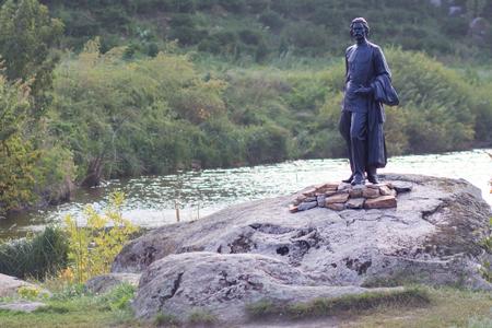 Monument to the Communist Soviet poet Maxim Gorky on the shore of a lake in the village Buki. Kiev region. Ukraine. Stock Photo
