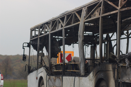 Burnt bus is seen on the street after caught in fire during travel, after fire