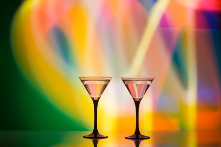 colourful cocktail on the club light background. Party club entertainment. Mixed light Stock Photo