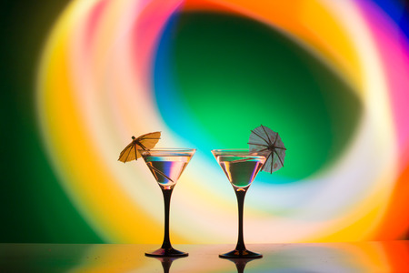 desk: Multicolored cocktails at the bar