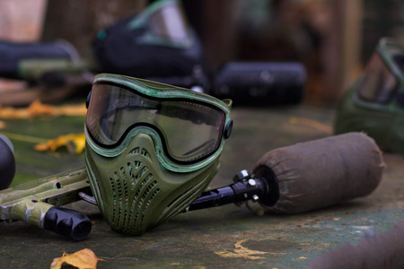Paintball Equipment Placed On Wooden Background Фото со стока - 90112167
