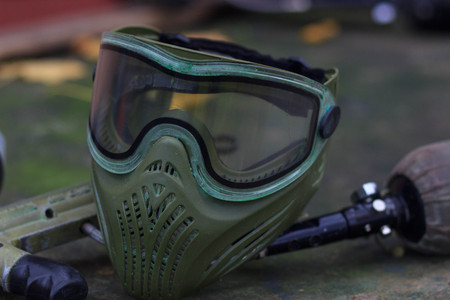 Paintball Equipment Placed On Wooden Background Фото со стока - 90052921