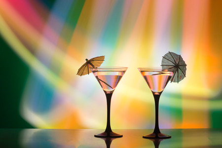 colourful cocktail on the club light background.