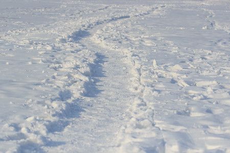 The path on the tundra in the snow.