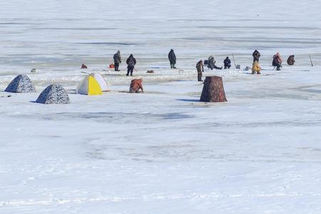 Cherkassy, Ukraine: fishermen fish on winter fishing