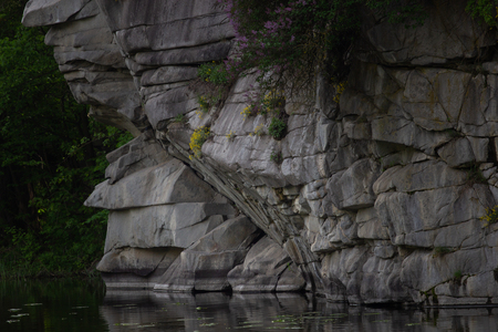 Beautiful Fjadrargljufur canyon with river and big rocks. Bucky Canyon fast river