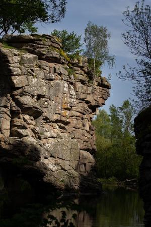 Beautiful Fjadrargljufur canyon with river and big rocks. Bucky Canyon fast river,