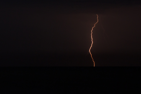 Fantastic view of electric firebolt flashing down towards the ground, climate Фото со стока