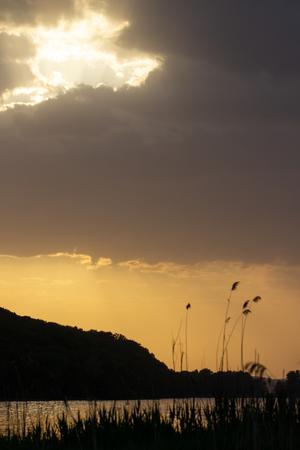 Sunset on the lake Фото со стока