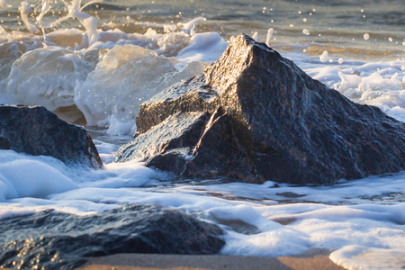 Powerful Waves crushing on a rocky beach.