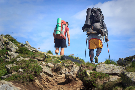hikers walking in the mountains. goal, success, freedom and achievement concept.