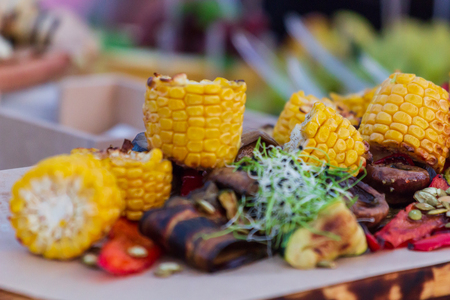 Grilled vegetables on cutting board on wooden