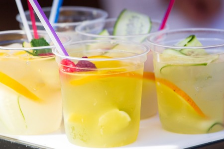 Summer cold cocktails with fruits and berries Фото со стока