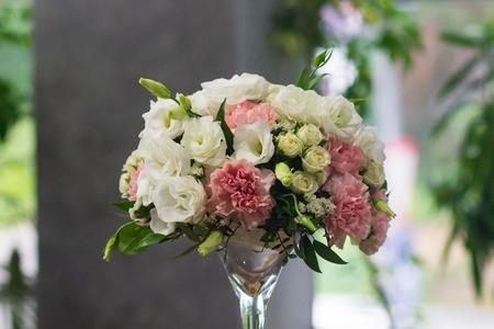 Beautiful flowers in vase on table in room.