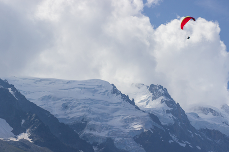 Paragliding over Mont Blanc massif in the French Alps above Chamonix Stock Photo