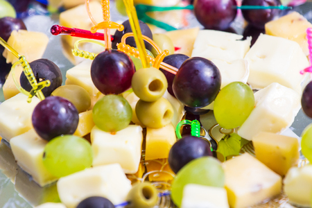 Canape with cheese, grape and olive. Catering Фото со стока