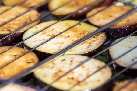 Background of grilled vegetables on a grill macro.