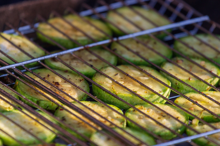 Grilled zucchini with addition of thyme, lemon zest and garlic.