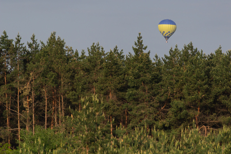 Colorful hot air balloon flying on sky. travel and air transportation concept .