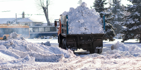 Snow-removal machine cleans the street of snow.