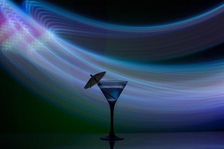 Two glasses of martini coctail in a bar.