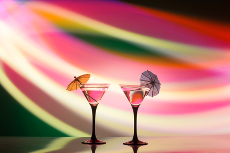 colourful cocktail on the club light background. Party club entertainment. Mixed light Фото со стока
