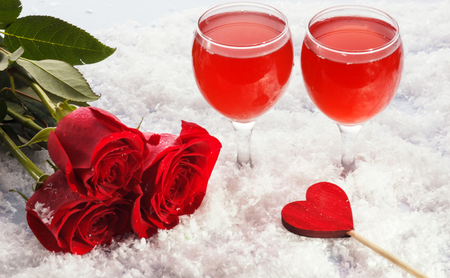Photo of beautiful Valentine day dinner still life, two glasses for champagne, alcohol beverage, romantic drink, sparkling wine, red rose and candle, festive table setting, love concept.