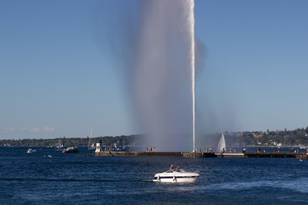 A half rainbow with big fountain in Geneva lake.