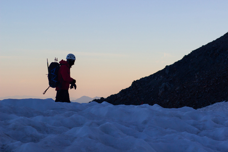 Climber reaches the summit of mountain peak. Success, freedom and happiness, achievement in mountains. Climbing sport concept
