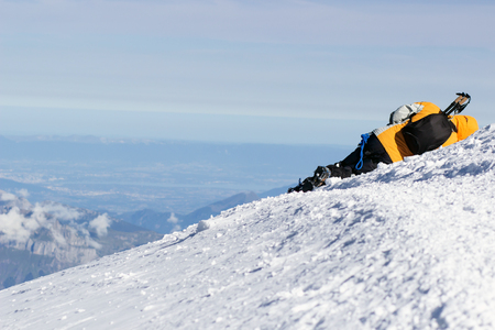 Climber fell and lies in the snow. Is sick mountaineer