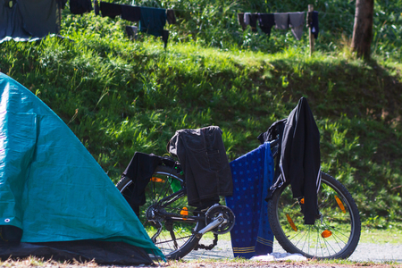 bike with things are dried in the sun on the campsite, the theme of rest and recreation.