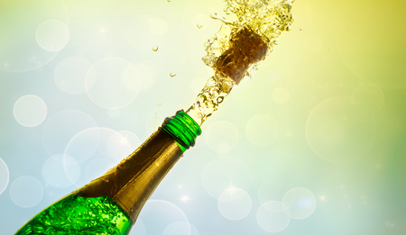 Close up of champagne cork popping on blokeh background.