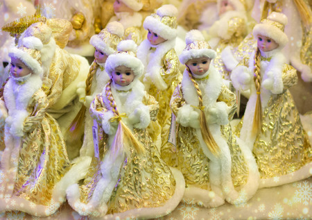 New year. Beautiful girl in a long yellow coat with white fur. Snow maiden (snow maiden) , a traditional Russian Christmas character.