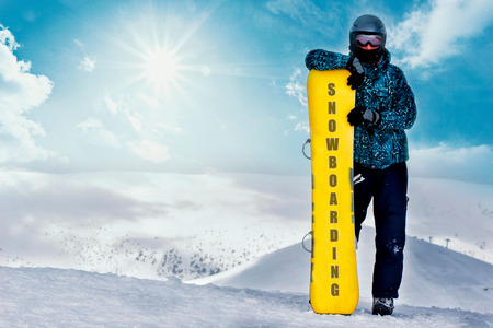 Snowboarder portrait with snowboard on mountain top. Snowboarding on ski resort, Banque d'images