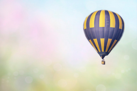 Hot air balloon over the field with blue sky Фото со стока