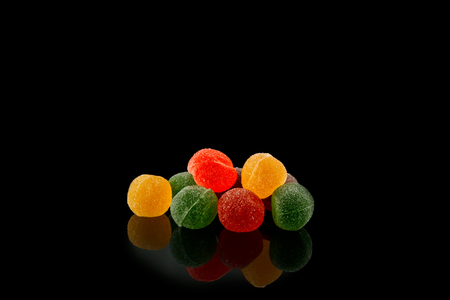 Multicolored, marmalade sweets on black background food