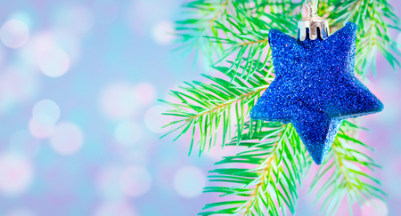 cristmas tree, cristmas tree on blue tone colour,cristmas tree with star decored on top Stock Photo